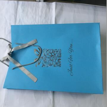 Silver Stamped Blue Paper Shopping Bag For Apparel